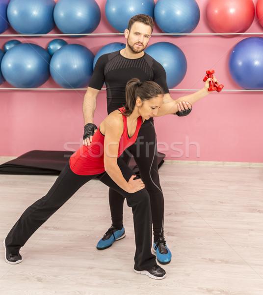 Para szkolenia siłowni młoda kobieta trenerem człowiek Zdjęcia stock © RazvanPhotography