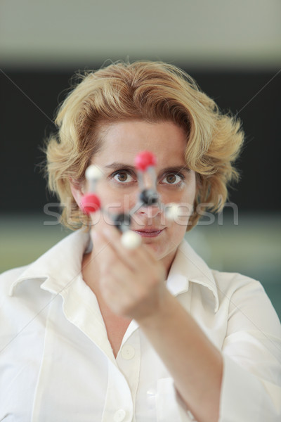 Female researcher analyzing a molecular structure Stock photo © RazvanPhotography