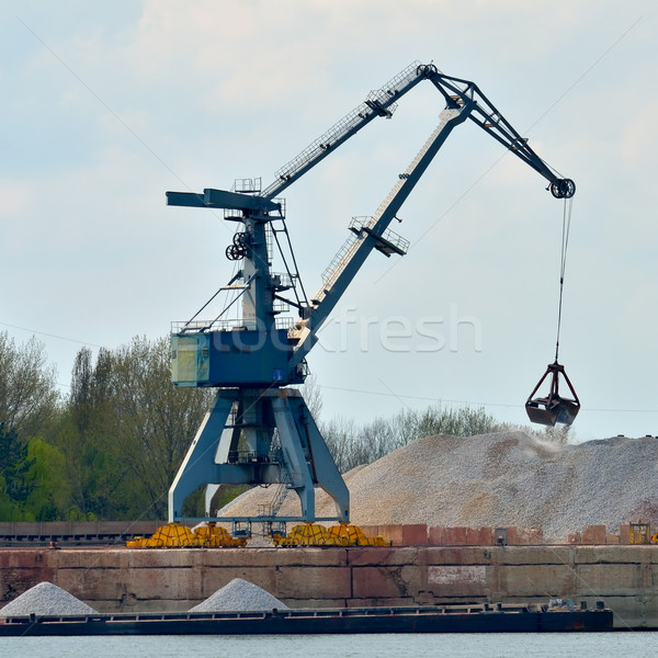 Crane loading industrial cargo ship with gravel Stock photo © razvanphotos