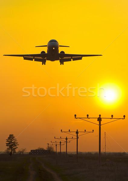 Mavi uçak düzlem gündoğumu hızlandırmak ışıklar Stok fotoğraf © razvanphotos