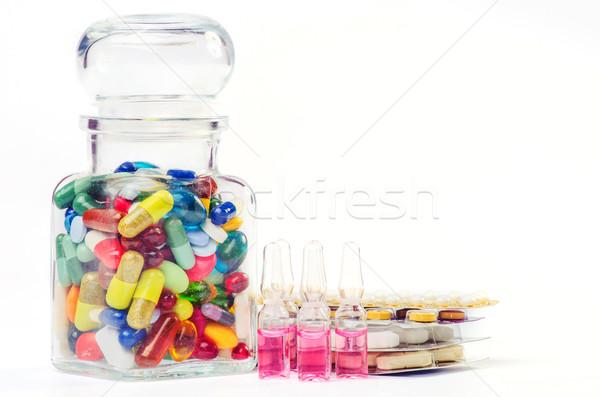 ampoule and pills shot Stock photo © razvanphotos
