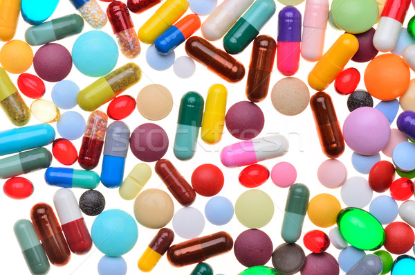 Muitos colorido pílulas isolado branco coração Foto stock © razvanphotos