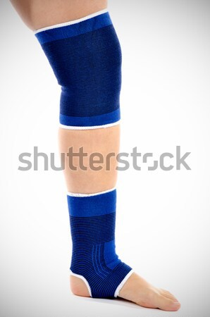 Woman with knee brace. Isolated. Stock photo © razvanphotos