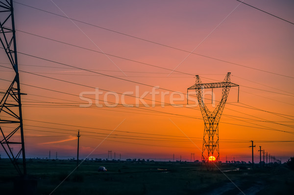 Silhouette electricity pylons during sunset Stock photo © razvanphotos