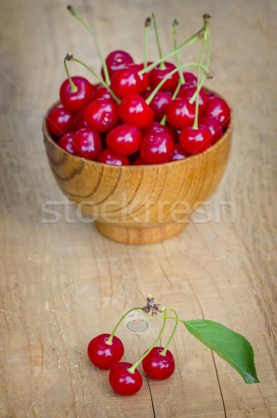 Cherry in wooden bowl Stock photo © razvanphotos