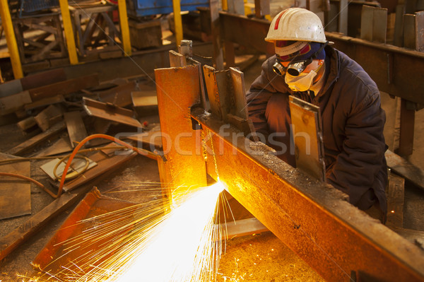 welder with protective mask welding metal and sparks Stock photo © razvanphotos