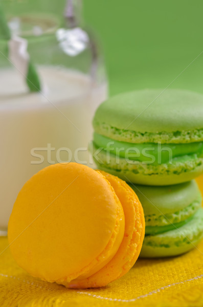 colorful macaroons and milk in a bottle with striped straws Stock photo © razvanphotos