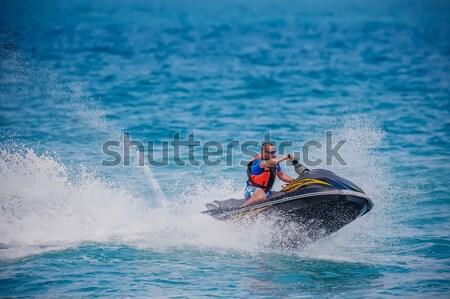 Young Man on Jet Ski, Tropical Ocean, Vacation Concept Stock photo © razvanphotos