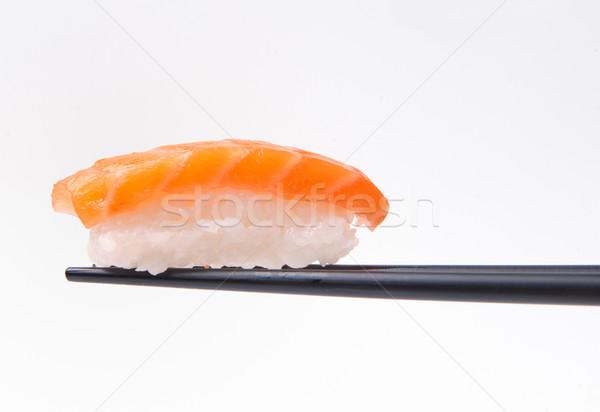 sushi on chopstick Stock photo © razvanphotos