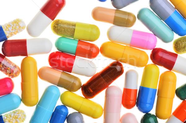 Many colorful pills isolated on white Stock photo © razvanphotos