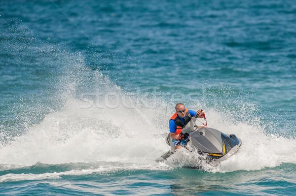 Fiatalember jet ski trópusi óceán vakáció férfi Stock fotó © razvanphotos