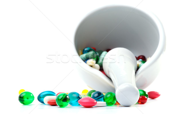 Mortar and pestle with pills against a white background Stock photo © razvanphotos