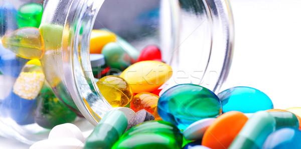 pills an pill bottle on white background Stock photo © razvanphotos