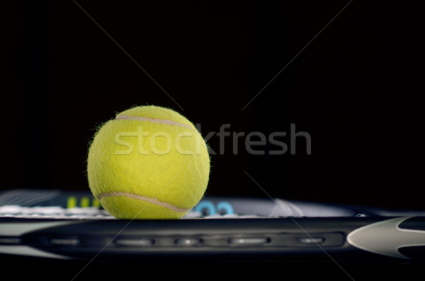 Tennis racket isolated on black background with tennis ball Stock photo © razvanphotos