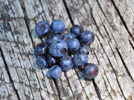 Bilberries on wood Stock photo © rbiedermann