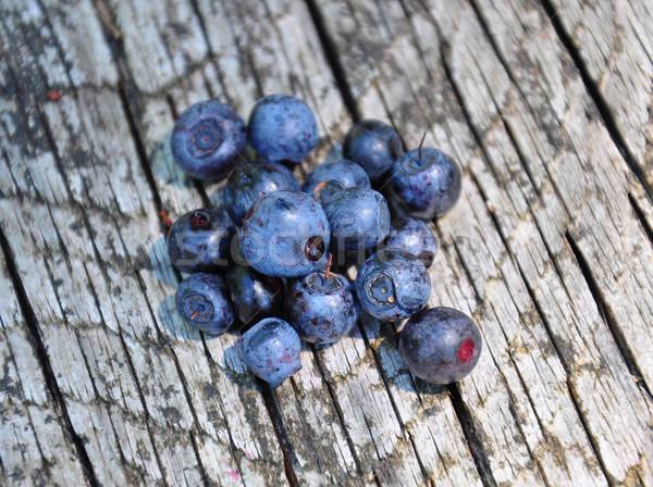 Wild bilberries on wood Stock photo © rbiedermann