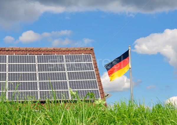 Roof with solar panels and German flag Stock photo © rbiedermann
