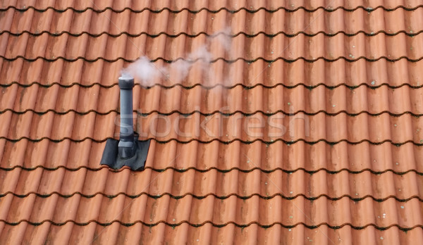 Smoking chimney on rooftop Stock photo © rbiedermann