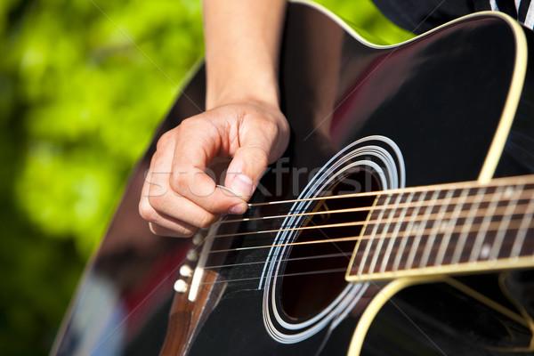 гитаре играет черный концерта фары инструмент Сток-фото © rbouwman