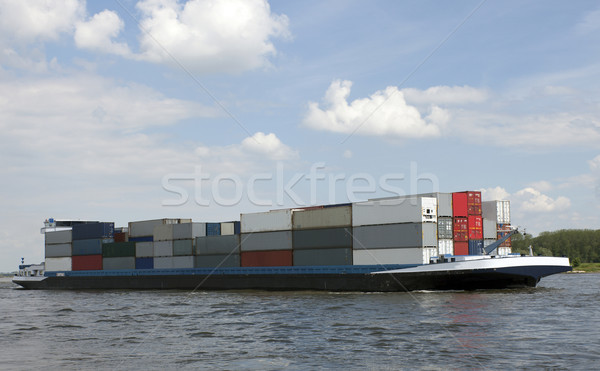 Сток-фото: бизнеса · воды · лодка · судно · реке · облаке