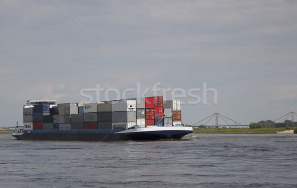 бизнеса воды лодка судно реке облаке Сток-фото © rbouwman