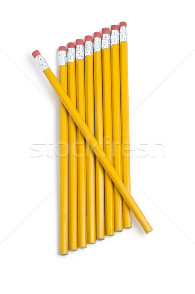 Slanted row of pencils with one diagonal Stock photo © rcarner
