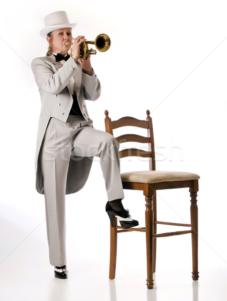 Pretty blonde woman playing a trumpet Stock photo © rcarner