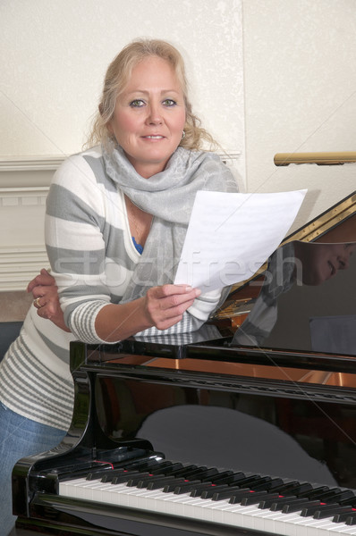 Pretty Blonde Woman Singing By A Piano Stock photo © rcarner