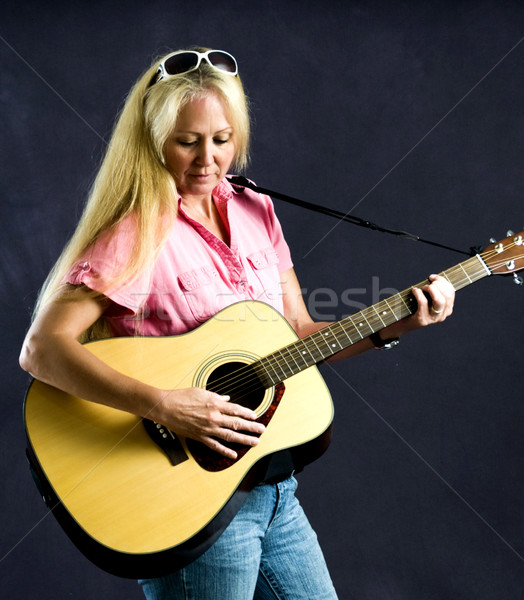 Pretty blonde woman playing guitar Stock photo © rcarner