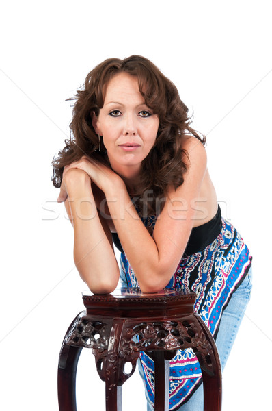 Pretty Brunette Leaning On a Stand Stock photo © rcarner