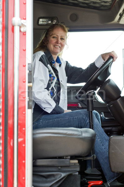 Pretty woman driving a big rig. Stock photo © rcarner