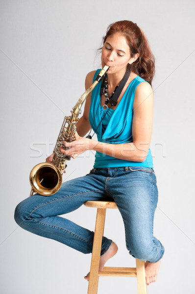 Beautiful young woman saxophone player Stock photo © rcarner
