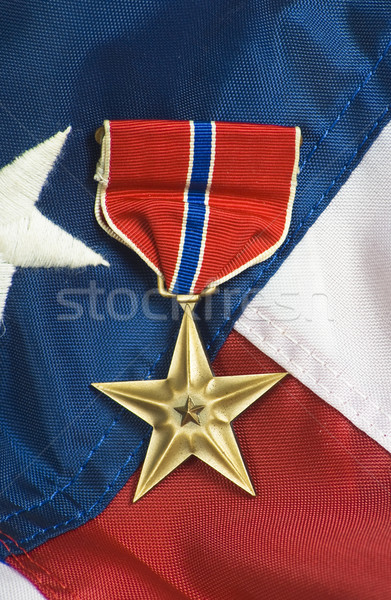 Bronze star on USA flag Stock photo © rcarner