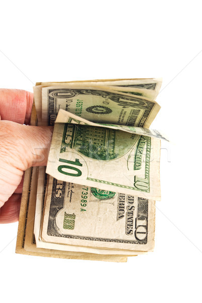Hand with folded small American bills Stock photo © rcarner