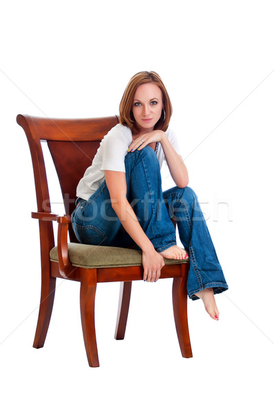 Pretty woman in an arm chair. Stock photo © rcarner