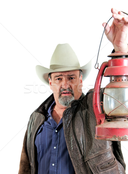 Adult male cowboy holding lantern Stock photo © rcarner
