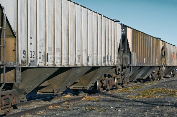 Row of railcars waiting to be loaded Stock photo © rcarner