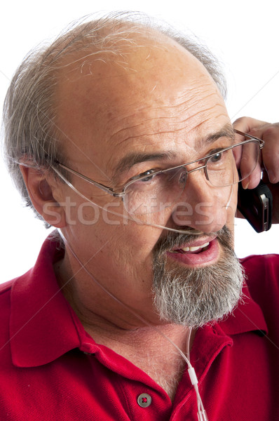 Man wearing a cannula for Oxygen talking on the phone Stock photo © rcarner