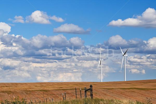 Giant wind turbines on the horizon Stock photo © rcarner
