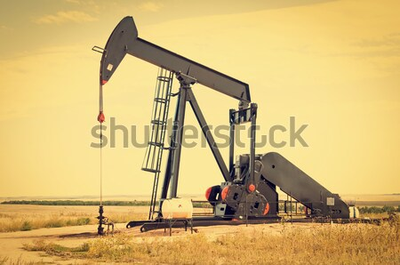 Raised pump jack in Colorado, USA Stock photo © rcarner