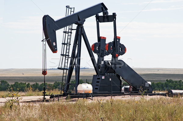 Stock photo: Pump jack lifting crude oil