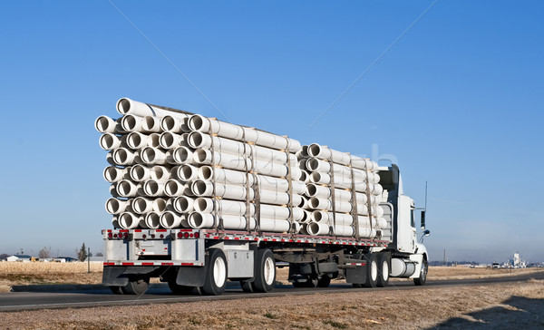 Semi-truck with a load of plastic pipe Stock photo © rcarner