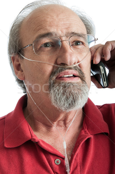 Senior male with breathing disability talking on the phone Stock photo © rcarner