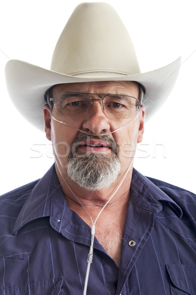 Mature cowboy with breathing disability Stock photo © rcarner