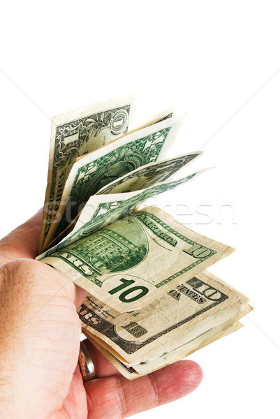 Male hand with American ten and one dollar bill. Stock photo © rcarner