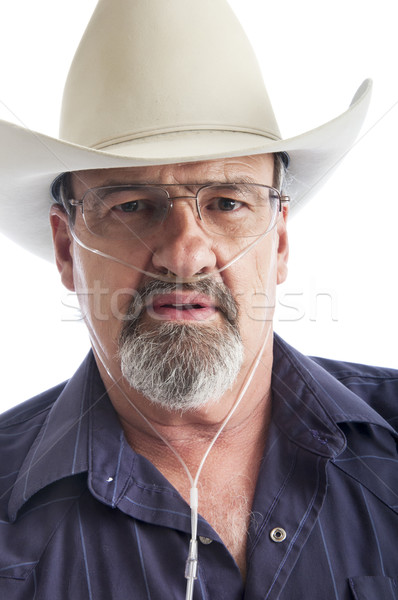 Adult man wearing a cowboy hat and Oxygen hose Stock photo © rcarner