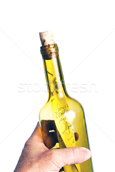 Hand with a note in a bottle Stock photo © rcarner