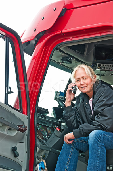 Stock photo: Pretty woman truck driver on phone