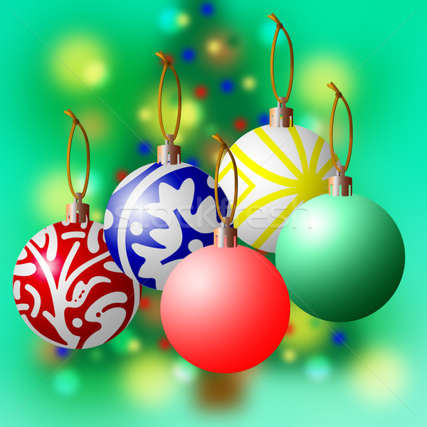 Christmas balls against a Green Blurred Tree Stock photo © rcarner