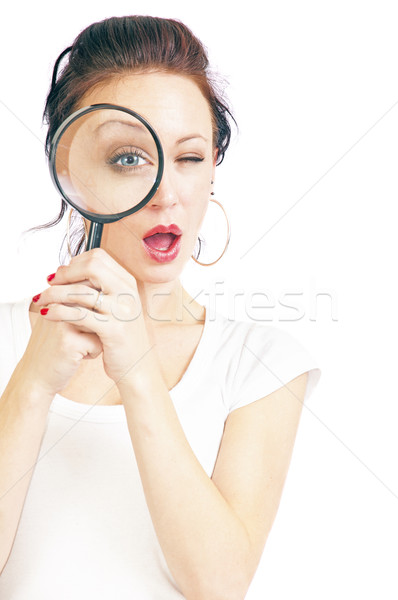 Pretty Young Woman With Magnifying Glass Stock photo © rcarner